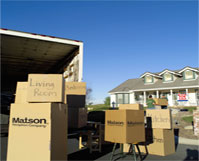 Moving boxes in front of house preparing for Matson household goods shipping.