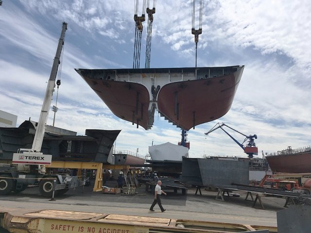 DKI's stern is carefully lowered into position.