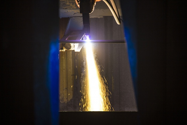 Sparks fly from the first piece of steel cut for Matsonia at NASSCO