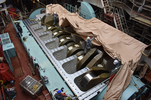 Philly Shipyard staff uncover the main engine bedplate in the engine room