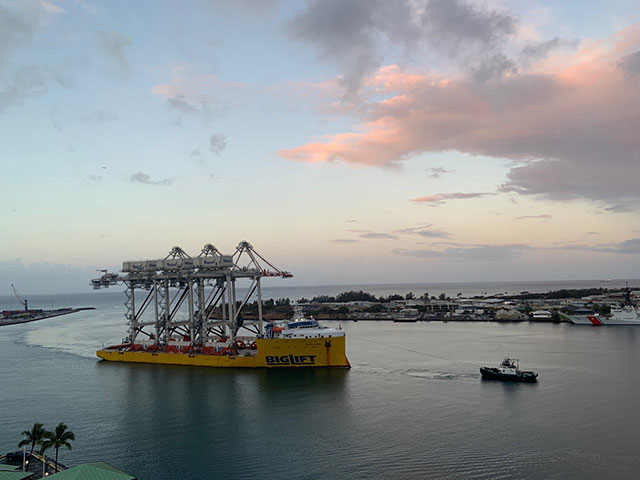 Sand Island cranes pulled into Honolulu Harbor by tug