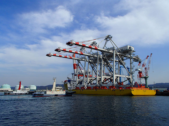 Cranes loaded onto barge in Japan depart for Sand Island