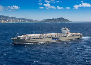 Aloha Class vessel DKI loaded with Matson containers and Diamond Head and Waikiki in the background.