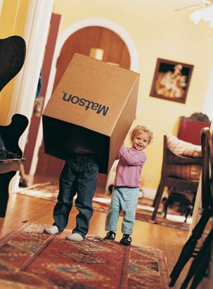 Children playing with Matson household shipping box.